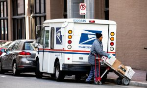 Protesters Stage Demonstration Outside Postmaster General's Home Amid USPS Controversy