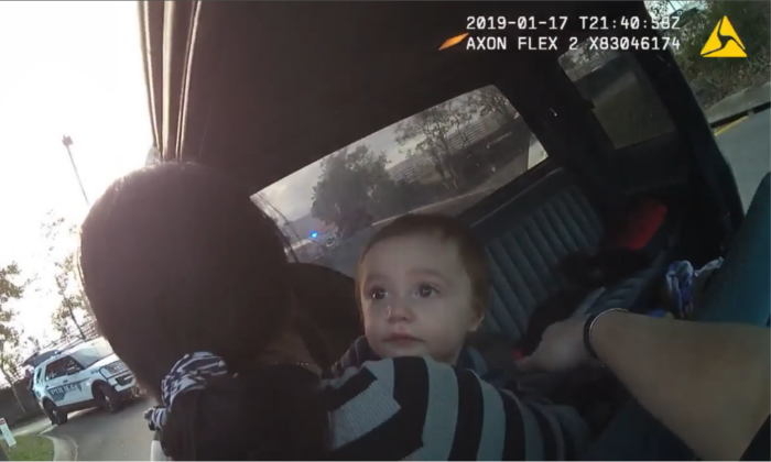 Body Camera footage from officers making an arrest, while a suspect, who is also the mother of the child, removes her son from the back of the vehicle. (Faceboook/City of Tallahassee Police Department)