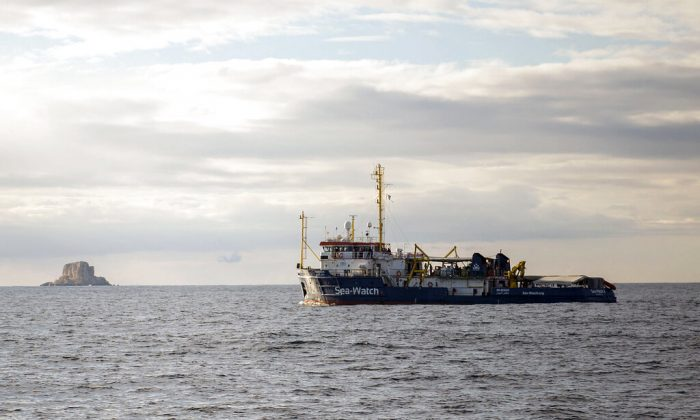 The Sea-Watch rescue ship waits off the coast of Malta. A migration official said survivors have told rescuers that up to 117 migrants might have died when a rubber dinghy capsized in the Mediterranean Sea off Libya. (Rene Rossignaud/AP Photo)