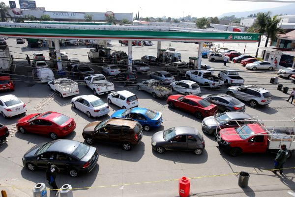Motorists queue at a Pemex service station in Zapopan, Jalisco State, Mexico, on Jan. 18, 2019 as a controversial government crackdown to fight fuel theft has led to severe gasoline and diesel shortages across much of the country. (Ulises Ruiz/AFP/Getty Images)