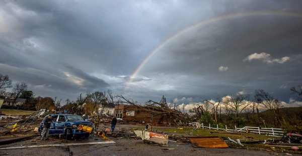 rainbow over damage from tornado