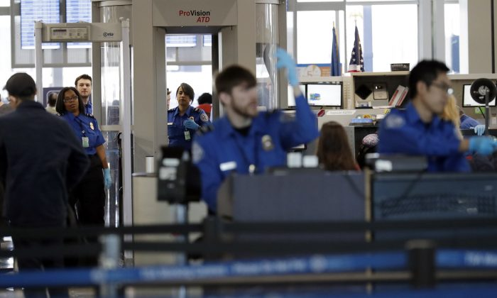 Transportation Security Administration officers work at a checkpoint at O'Hare airport in Chicago on Jan. 5, 2019. (AP Photo/Nam Y. Huh, File)