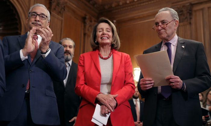 (L-R) House Education and Labor Chairman Bobby Scott (D-VA), Speaker of the House Nancy Pelosi (D-CA) and Senate Minority Leader Charles Schumer (D-NY) attend an event to introduce the Raise The Wage Act in the Rayburn Room at the U.S. Capitol in Washington on Jan. 16, 2019. (Chip Somodevilla/Getty Images)