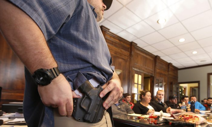 A man demonstrates a holster at a gun concealed carry permit class put on by USA Firearms Training in Provo, Utah, on Dec. 19, 2015.  (George Frey/Getty Images)