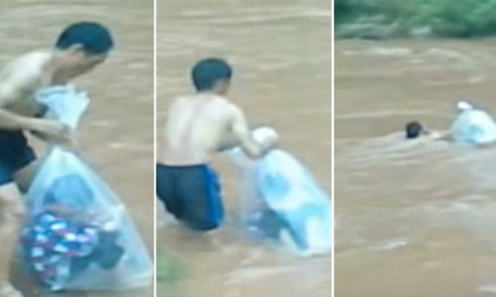 A school teacher from Vietnam's Sam Lang village puts a student inside a plastic bag before transporting him to their classroom on the other side of a flooded river. (YouTube Screenshot | Optrex)