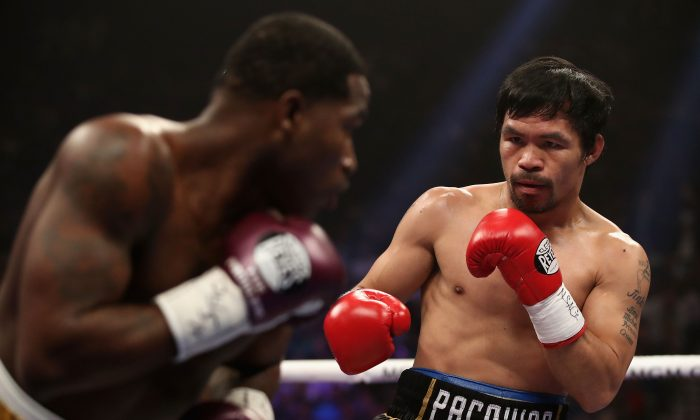Manny Pacquiao (R) squares up with Adrien Broner during the WBA welterweight championship at MGM Grand Garden Arena in Las Vegas on Jan. 19, 2019. (Christian Petersen/Getty Images)