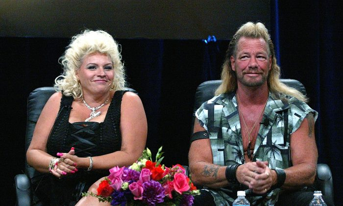 "Bounty Hunter Dog Chapman (R) and his wife Beth Chapman of ""Dog The Bounty Hunter"" speaks with the press at the TCA Press Tour Cable at the Century Plaza Hotel on July 21, 2004 in Los Angeles, California. (Frederick M. Brown/Getty Images)"
