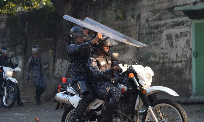 Riot police hold a shield during clashes with anti-government demonstrators in the neighborhood of Los Mecedores, in Caracas, on Jan. 21, 2019. (Federico Parra/AFP/Getty Images)