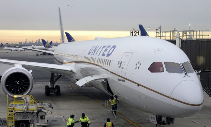 A Dreamliner 787-10 arriving from Los Angeles pulls up to a gate in Newark Liberty International Airport in Newark, N.J., on Jan. 7, 2019. (AP Photo/Seth Wenig)