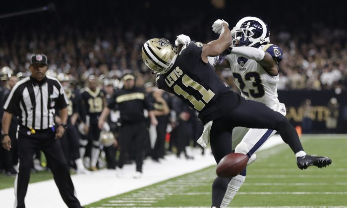 New Orleans Saints wide receiver Tommylee Lewis is hit by Los Angeles Rams defensive back Nickell Robey-Coleman during the second half the NFL football NFC championship game in New Orleans, on Jan. 20, 2019. (Gerald Herbert/AP Photo)