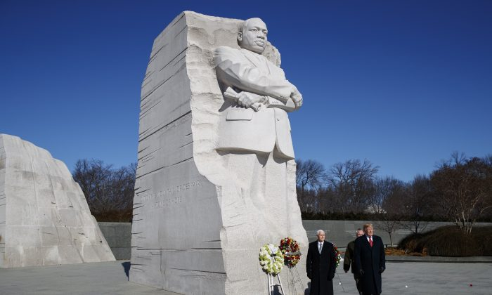 President Donald Trump (R) and Vice President Mike Pence (L) visit the Martin Luther King Jr. Memorial in Washington on Jan. 21, 2019. (Evan Vucci/AP Photo)