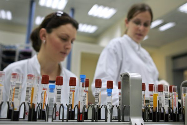 lab techs supervise blood tests