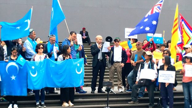 Omer Kanat, from the World Uyghur Congress, speaks at a Human Rights Walk rally in Melbourne, Australia on Dec. 9, 2018. Omer Kanat is calling on the Australian Government to demand the Chinese Regime stop the ongoing repression in East Turkistan/Xinjiang Province. (Rita Li/Epoch Times)