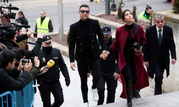 Soccer player Cristiano Ronaldo arrives with his girlfriend, Georgina Rodriguez, to appear in court on a trial for tax fraud in Madrid, Spain, Jan. 22, 2019. (Reuters/Sergio Perez)