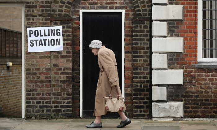 A member of the public arrives to cast her vote in the EU referendum at Royal Hospital Chelsea on June 23, 2016, in London. Photo by Dan Kitwood/Getty Images