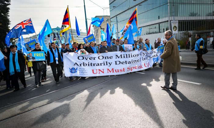 Uyghurs and Tibetans demonstrate against China outside of the United Nations (UN) offices during the Universal Periodic Review of China by the UN Human Rights Council in Geneva on Nov. 6, 2018. (FABRICE COFFRINI/AFP/Getty Images)