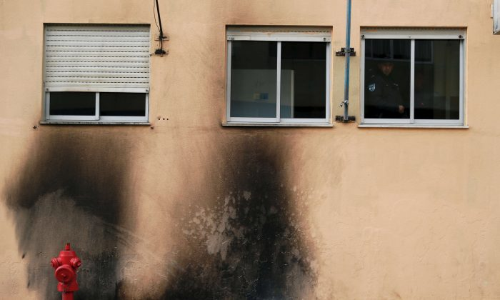 Damage caused by molotov cocktails on the police station building at the Bela Vista neighborhood in Setubal, Portugal, on Jan. 22, 2019. (Reuters/Rafael Marchante)