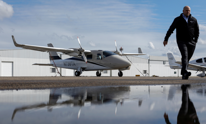Coast Flight Training president Bryan Simmons walks past some of his company's training aircraft used for instruction in San Diego, California, U.S., January 15, 2019. Picture taken January 15, 2019.    REUTERS/Mike Blake