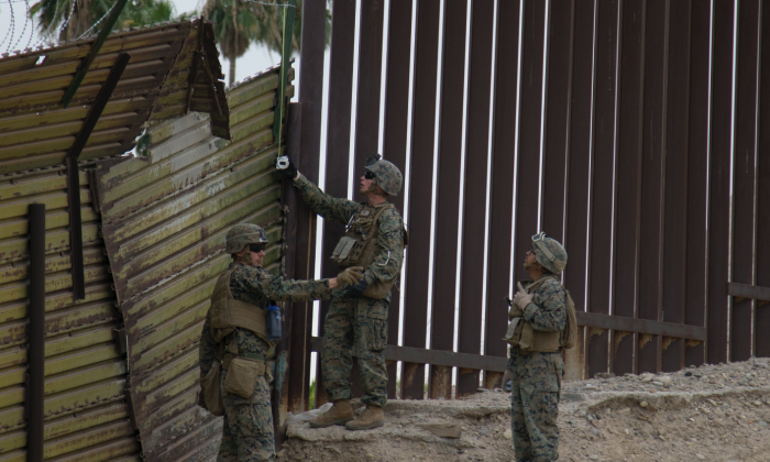 U.S. Marines shore up the old landing mat fence (left) next to a steel slat barrier on the U.S.–Mexico border near the Andrade port of entry in Calif. on Nov. 29, 2018. (U.S. Army photo by Staff Sgt. Jesse Untalan)