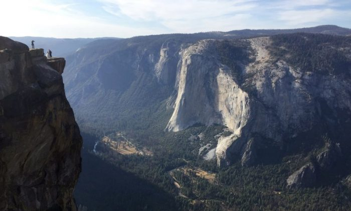 "In this Thursday, Sept. 27, 2018 file photo, an unidentified couple gets married at Taft Point, upper left, in California's Yosemite National Park. A Northern California coroner says a young couple from India was intoxicated when the pair fell to their deaths from the scenic overlook in Yosemite. Autopsy reports provided by the Mariposa County sheriff's department Friday, Jan. 18, 2019 concluded that 30-year-old Meenakshi Moorthy and her husband, 29-year-old Vishnu Viswanath, were both ""intoxicated with ethyl alcohol prior to death."" (AP Photo/Amanda Lee Myers, File)"