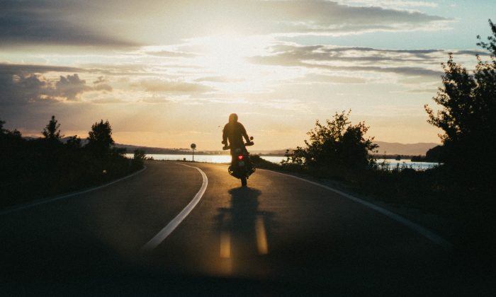 A motorcyclist enjoying the open road. (Pexels)