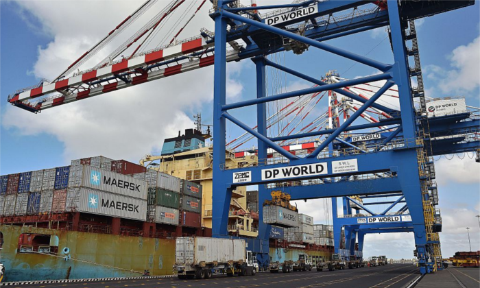Cranes and trucks get ready near a container ship in the Doraleh harbor in Djibouti on May 5, 2015. (Carl de Souza/AFP/Getty Images)