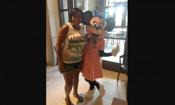 Keisha Williams, 43, on a 2016 trip to Disney World, was sentenced to 15.5 years in prison for engaging in a huge fraud scheme. (U.S. Attorney's Office for the Eastern District of Virginia)