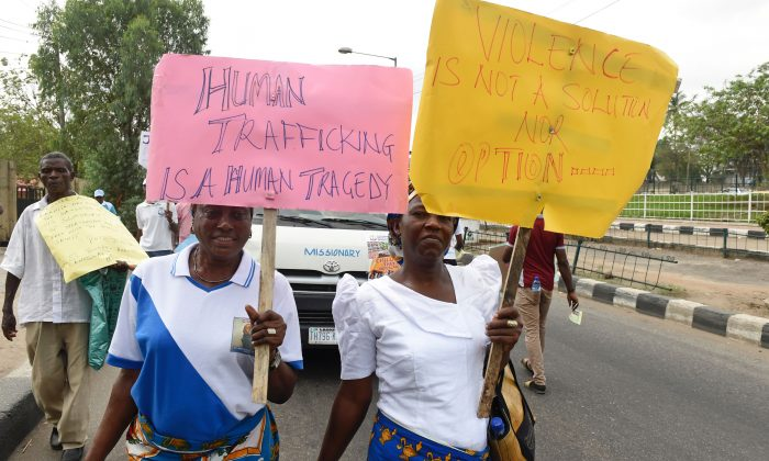 Women carry placards during a march against violence and human trafficking on March 18, 2017 in Lagos, Nigeria. (Pius Utomi Ekpei/AFP/Getty Images)