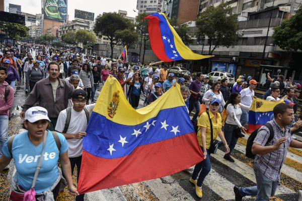 Venezuelan opposition supporters take part in a a march on the anniversary of 1958 uprising that overthrew military dictatorship in Caracas on Jan. 23, 2019. (Luis Robayo/AFP/Getty Images)