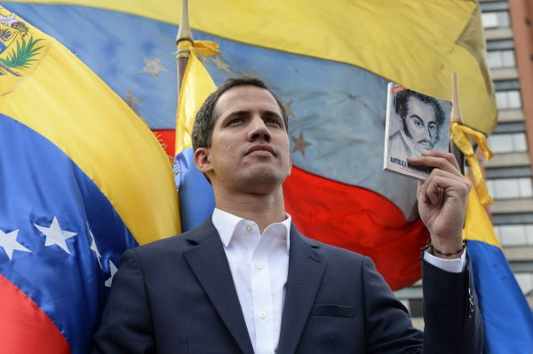 "Venezuela's National Assembly head Juan Guaido declares himself the country's ""acting president"" during a mass opposition rally against leader Nicolas Maduro, on the anniversary of 1958 uprising that overthrew military dictatorship in Caracas on Jan. 23, 2019. -(Federico Parra/AFP/Getty Images)"