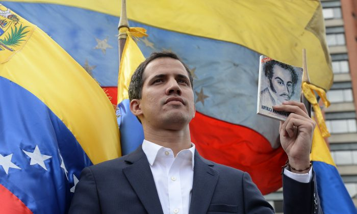 "Venezuela's National Assembly head Juan Guaido declares himself the country's ""acting president"" during a mass opposition rally against leader Nicolas Maduro, on the anniversary of 1958 uprising that overthrew military dictatorship in Caracas on Jan. 23, 2019. (Federico Parra/AFP/Getty Images)"