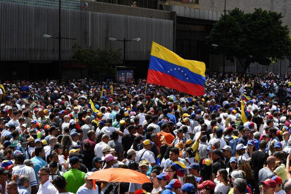 Venezuelan opposition supporters take to the streets to protest against the government of President Nicolas Maduro on Jan. 23, 2019. (Yuri Cortez/AFP/Getty Images)
