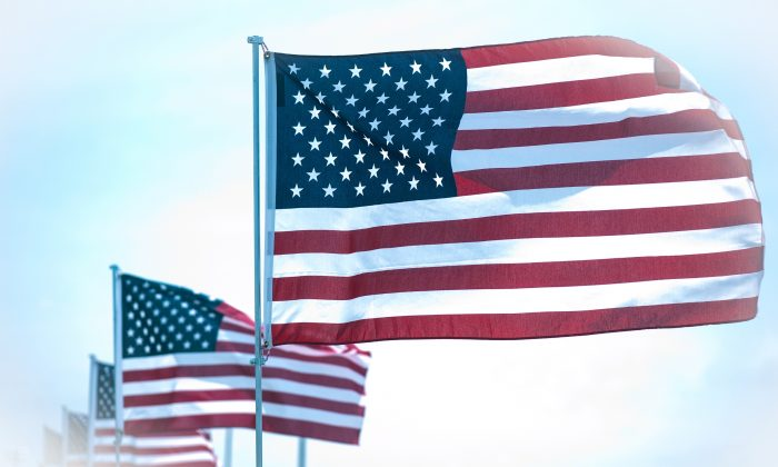 American flags flying in a file photo. (Cat Rooney/The Epoch Times)