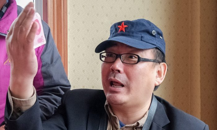 Yang Hengjun, author and former Chinese diplomat, who is now an Australian citizen, gestures in an unspecified location in Tibet, China, sometime in mid-July, 2014 in this social media image obtained by Reuters.