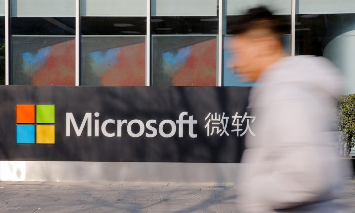 A man walks past the office of Microsoft in Beijing on Jan. 24, 2019. (Thomas Peter/Reuters)