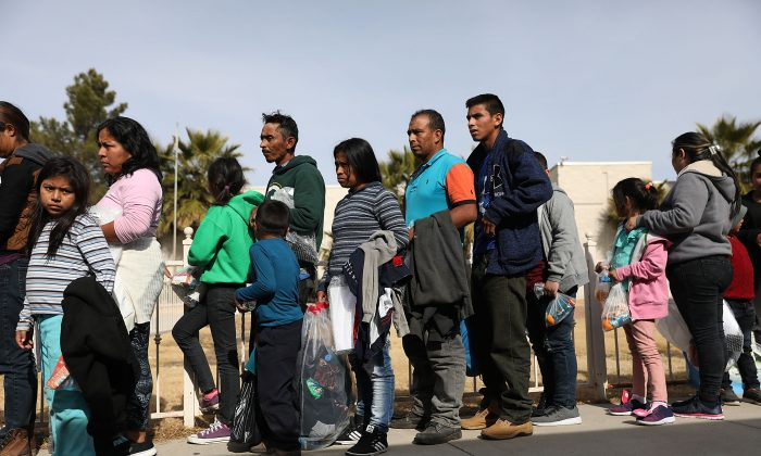 Migrants arrive at a church facility after being released by Immigration and Customs Enforcement in El Paso, Texas, on Jan. 14, 2019. in El Paso, Texas. (Joe Raedle/Getty Images)
