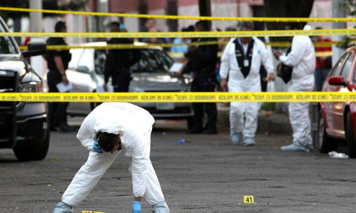 A stock photo shows forensic experts are seen at the scene of the crime in Guadalajara, Jalisco state, on Jan.  18, 2019. (Ulises Ruiz/ AFP/Getty Images)