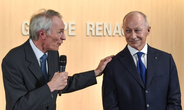 French carmaker Renault's newly appointed board chairman Jean-Dominique Senard (L) delivers a speech next to new chief executive Thierry Bollore during a press conference at the headquarters of the French car manufacturer Renault in Boulogne Billancourt, near Paris, on Jan. 24, 2019. (Eric Piermont/AFP/Getty Images)