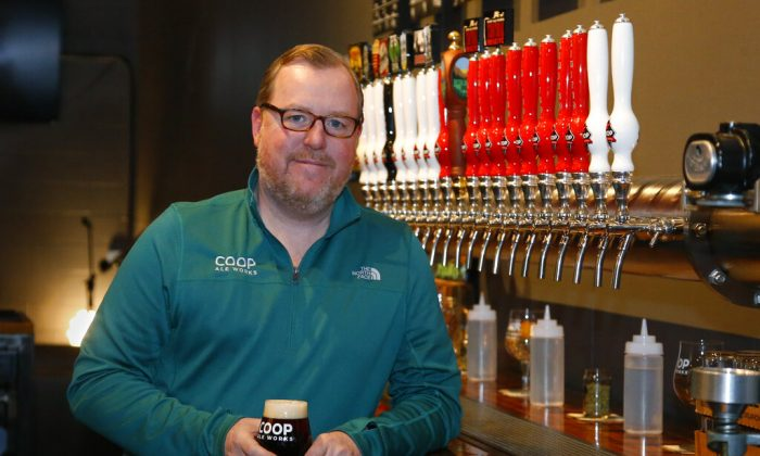 Sean Mossman, director of sales and marketing for COOP Ale Works, poses for a photo in the COOP taproom in Oklahoma City, Friday, Jan. 18, 2019. (AP Photo/Sue Ogrocki)