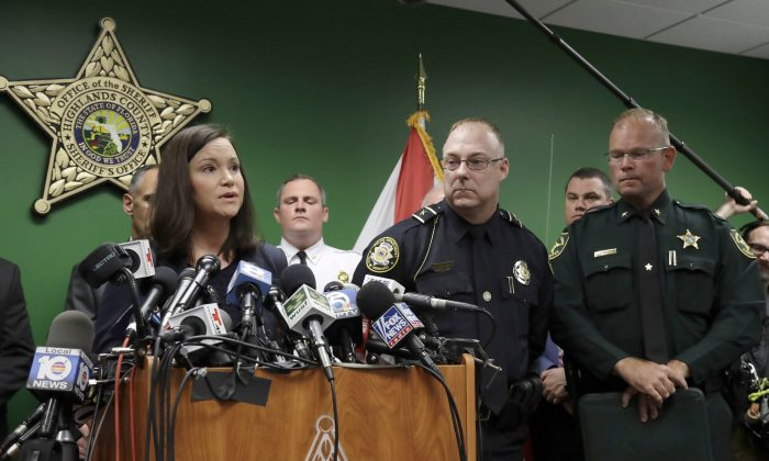 Florida Attorney General Ashley Moody, left, addresses the media as she stands with Sebring Police Chief Karl Hoglund, center, and Highlands County Sheriff Paul Blackman during a news conference, in Sebring, Fla. on Jan. 24, 2019.(AP Photo/Chris O'Meara)