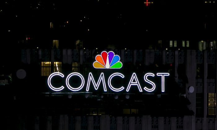 The NBC and Comcast logo are displayed on top of 30 Rockefeller Plaza in midtown Manhattan in New York July 1, 2015.  (Reuters/Brendan McDermid)