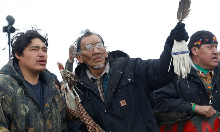 Nathan Phillips (C), with other protesters near the main opposition camp against the Dakota Access oil pipeline near Cannon Ball, N.D., on Feb. 22, 2017. (Teray Sylvester/Reuters)