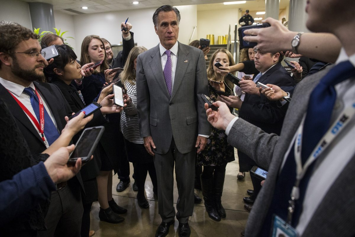 Sen. Mitt Romney speaks to reporters near the Senate Subway on Capitol Hill