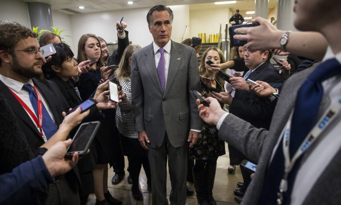 Sen. Mitt Romney speaks to reporters near the Senate Subway on Capitol Hill on Jan. 24, 2019. (Zach Gibson/Getty Images)