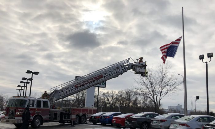 Firefighters fix an upside-down American flag on Jan. 19, 2019. (Independence Police Department)