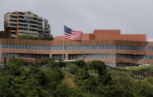 A U.S flag flies outside the U.S. embassy in Caracas