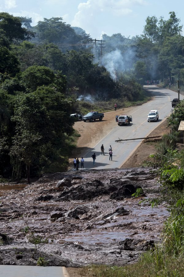 A road is blocked after a dam collapsed