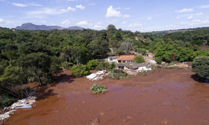 An aerial view shows flooding triggered by a collapsed dam near Brumadinho, Brazil, on Jan. 25, 2019. (Bruno Correia/Nitro via AP)