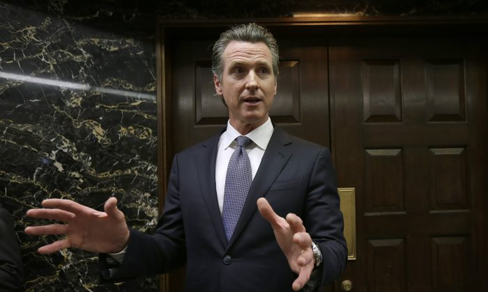 California Gov. Gavin Newsom discusses the results of an investigation that found Pacific Gas & Electric was not responsible for the Tubbs Fire in Sacramento, Calif., on Jan. 24, 2019. (Rich Pedroncelli/AP)