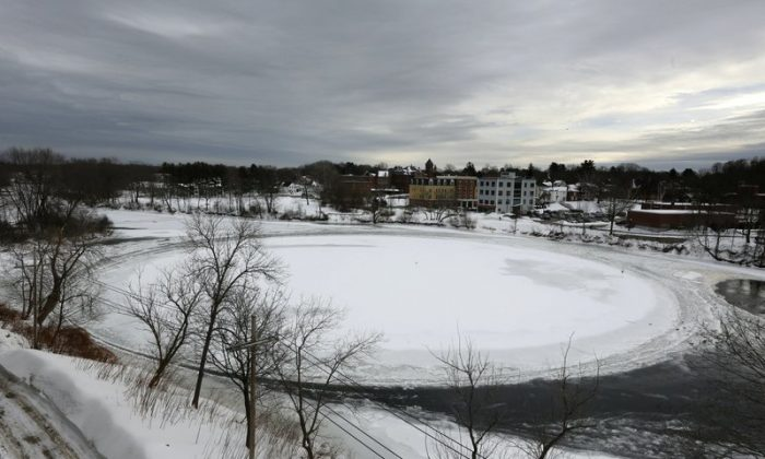 A naturally occurring ice disk that gained international fame appears to be freezing in place following a stretch of frigid weather, Jan. 23, 2019, in Westbrook, Maine. The giant ice disk on the Presumpscot River now has its own webcam. (AP Photo/Robert F. Bukaty)